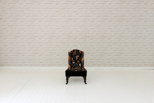 A Victorian nursing chair with Malian mud cloth upholstery