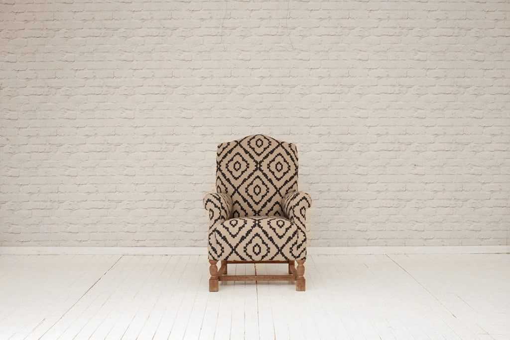 A late 19th century wingback armchair in grey wool with felted blue pattern