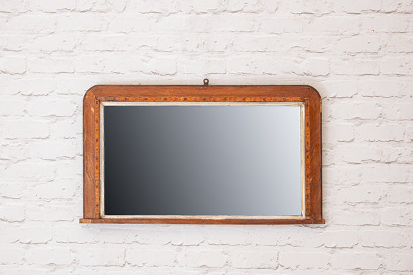 An antique over-mantle mirror