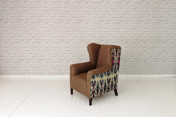 An Edwardian wingback armchair in cotton & Uzbek Ikat