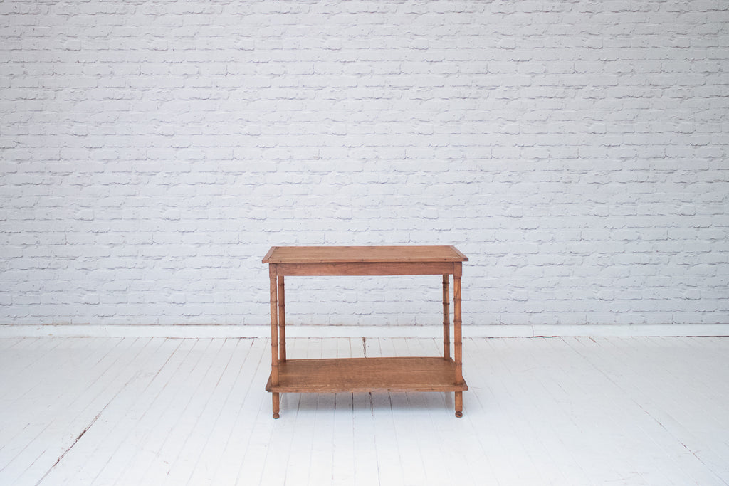 A vintage Javanese teak two tier side table