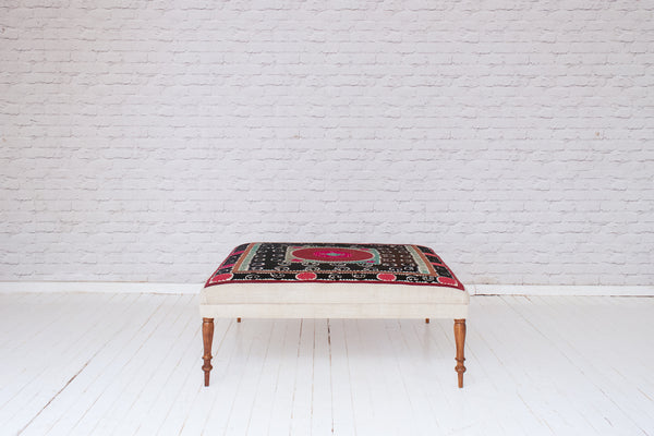 Zanzibar ottoman upholstered in vintage embroidered Suzani