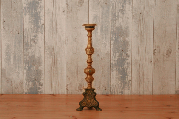 A single vintage brass church candlestick