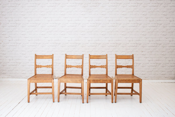 A set of four early 19th century oak dining chairs