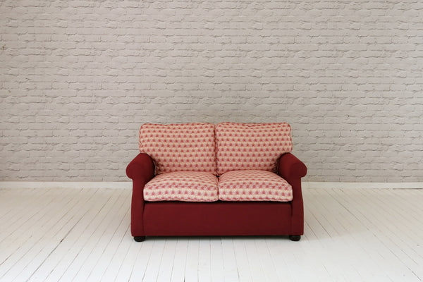 A contemporary feather filled two seater sofa in Foy & Co fabrics
