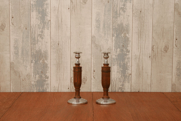 A pair of retro wood & chrome candlesticks