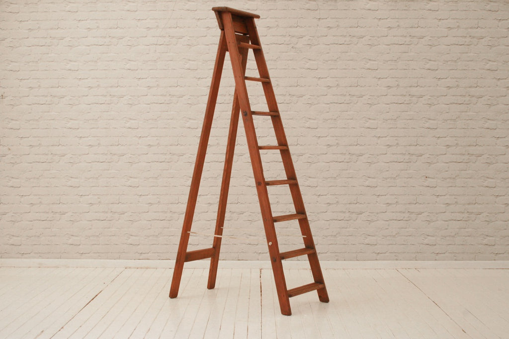 A large vintage pine stepladder