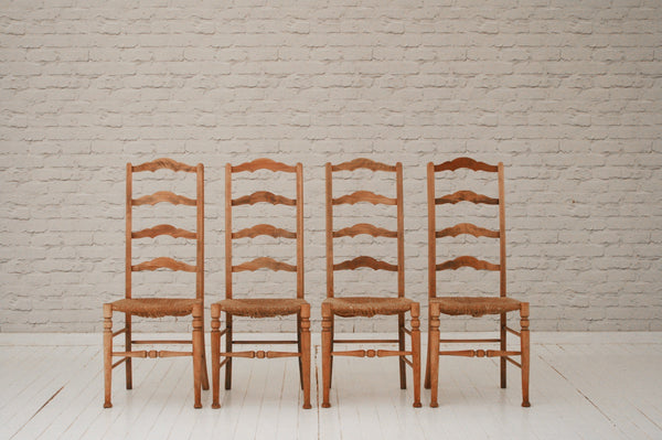 Four beech ladder back and rush seated dining or kitchen chairs
