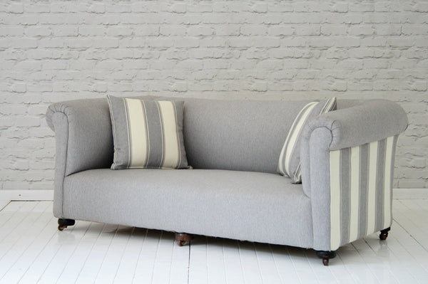 A Victorian chesterfield sofa in Foy & Co grey herringbone wool
