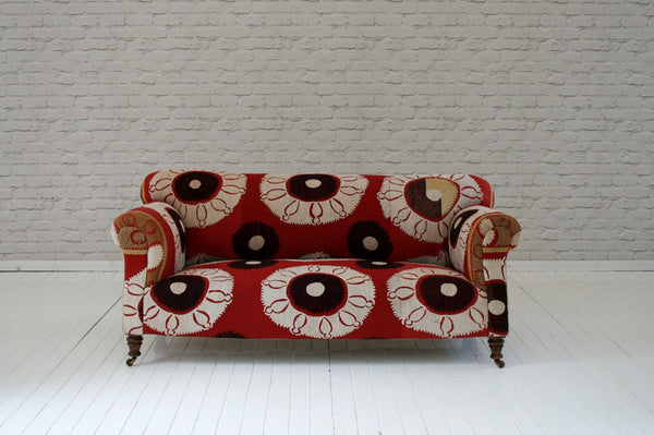 A Victorian roll top chesterfield sofa in vintage Suzani fabric