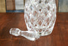A vintage clear crystal decanter