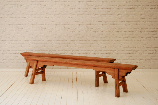 A pair of late 19th Century Chinese pine benches