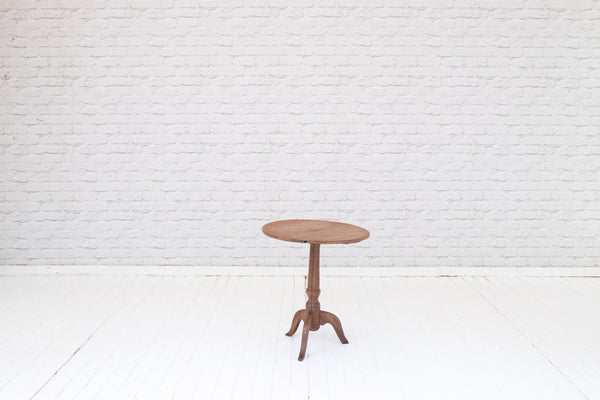 A vintage oak tripod side table