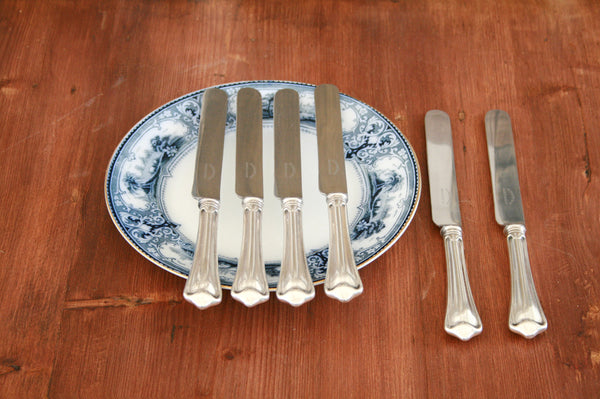 A set of six silver plated dinner knives