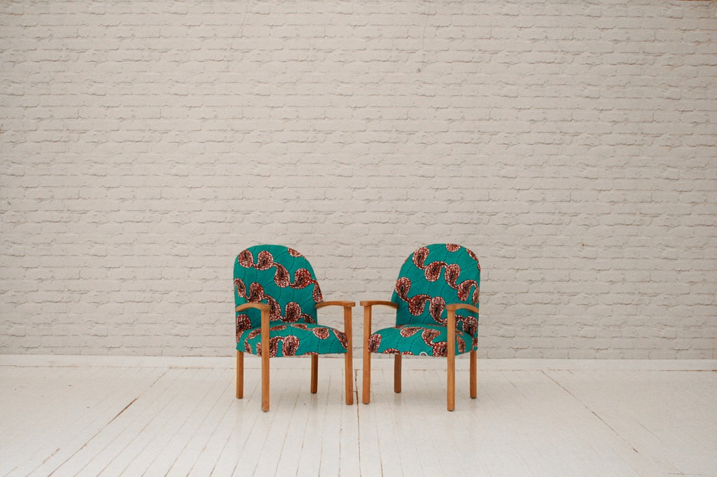 A pair of 1940's beech elbow chairs in Rwandan wax cloth / Armcchairs