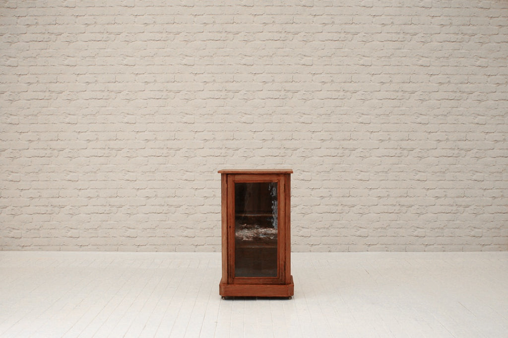 A walnut glass fronted  cabinet