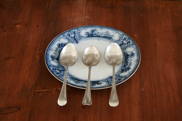 A set of three silver plated dessert spoons