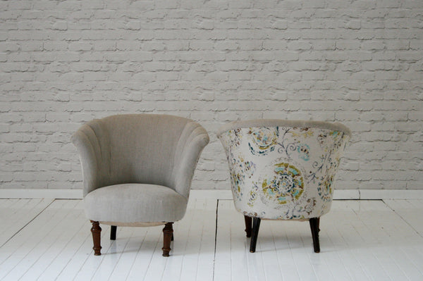 A pair of Art Deco shell back armchairs