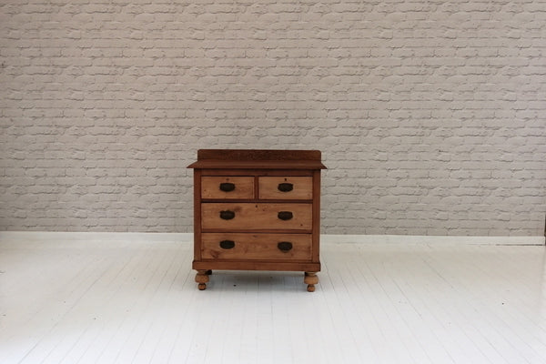 An Elm two over two chest of drawers