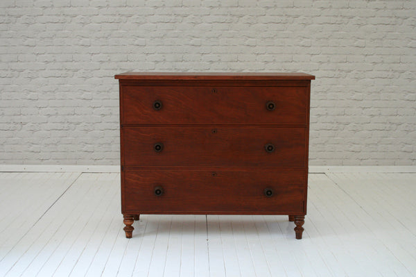 A Victorian mahogany chest of drawers with beautifully turned pull handles