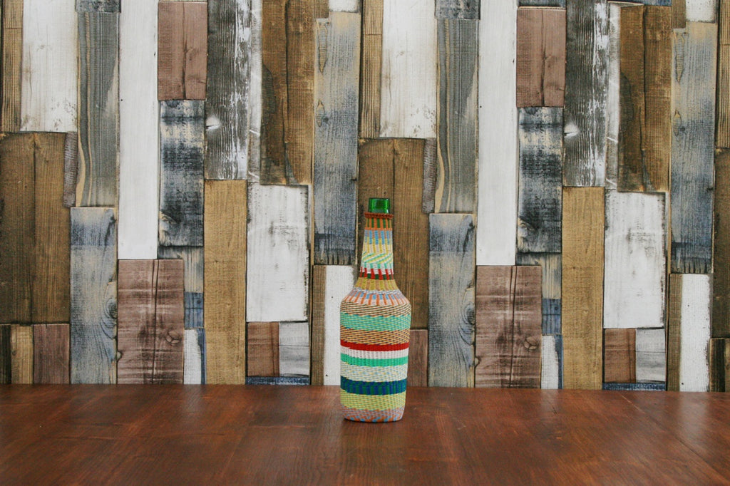 A vintage Hungarian bottle with hand woven decorative cover