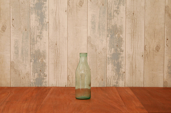 A Hungarian recycled green glass bottle (large)
