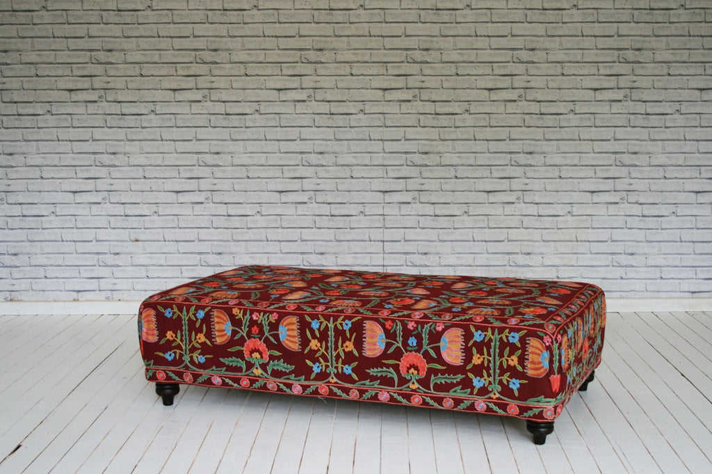 An exquisite ottoman / coffee table in vintage Suzani cloth