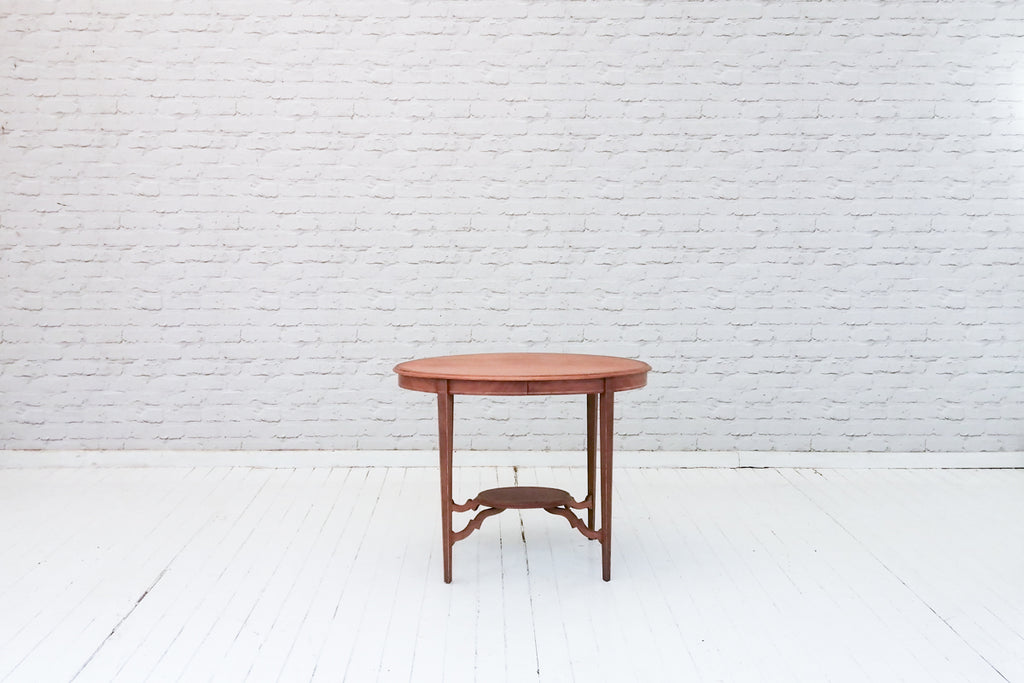 An Edwardian inlaid mahogany two tier occasional table