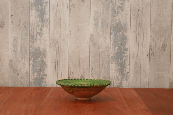A handmade green glazed French serving bowl