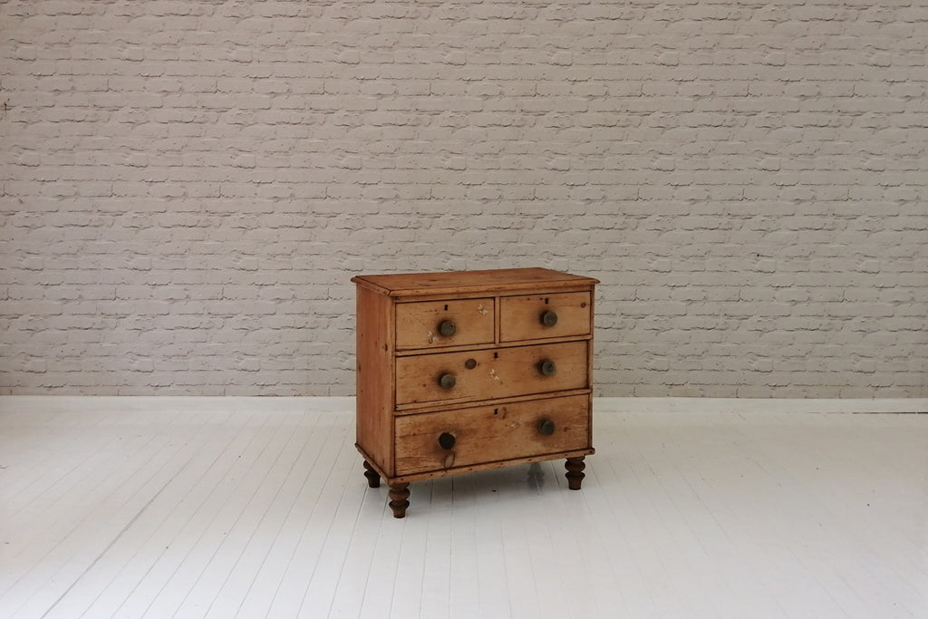 A Victorian pine chest of two over two drawers