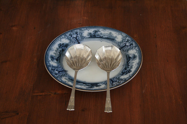 A set of two silver plated serving spoons