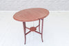 An Edwardian mahogany drop leaf occasional table with folding base
