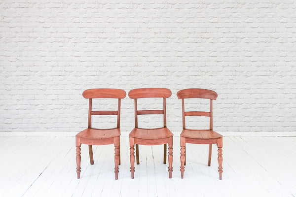 A set of three Victorian mahogany bar back kitchen chairs