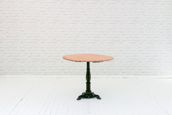 A 19th Century cast iron American bar base table with oak top