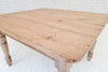 A Victorian pine plank top farmhouse table on elm base