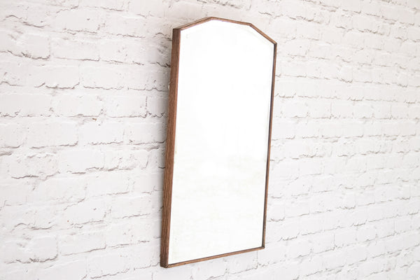 A vintage oak bevelled edge mirror
