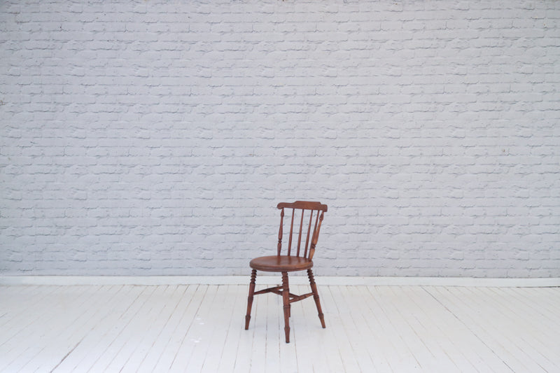 A stick back kitchen chair