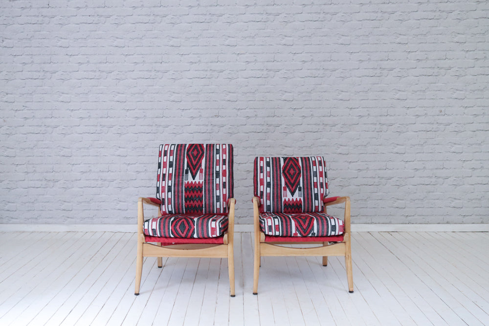 "A pair of vintage ""Cintique"" armchairs upholstered in West African Fulani cotton blankets"