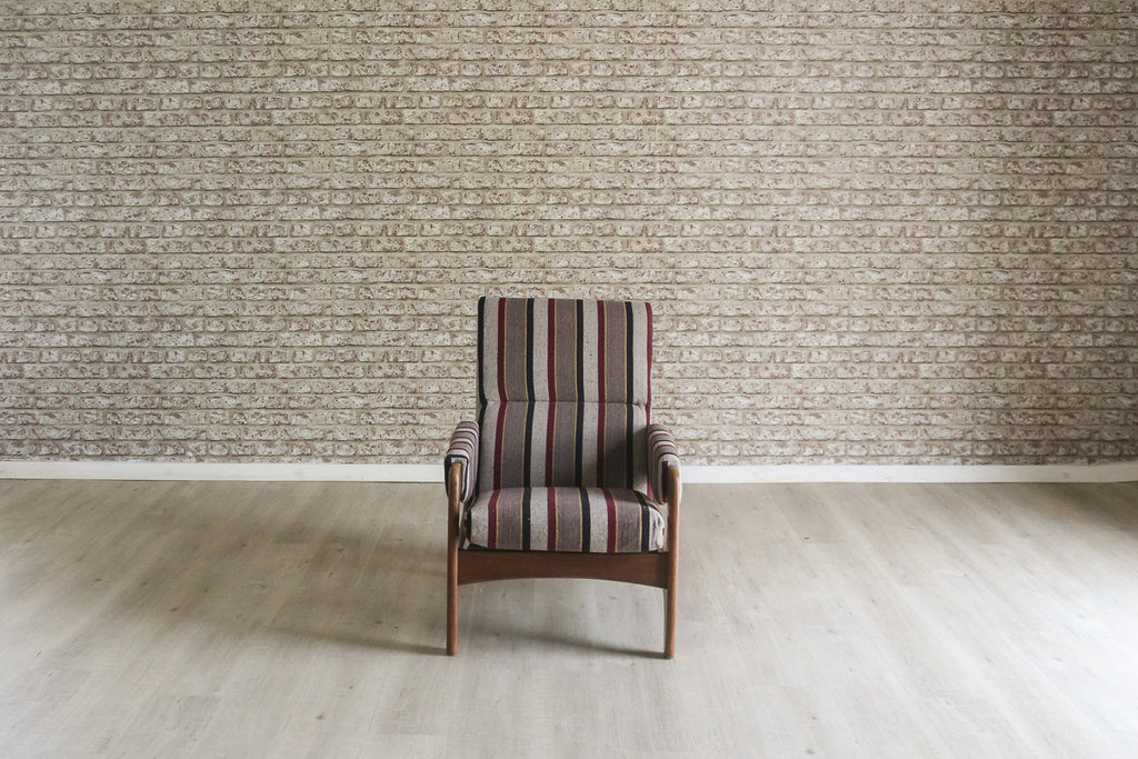 A 1970s armchair upholstered in striped Egyptian cotton from the Tentmakers bazaar, Cairo
