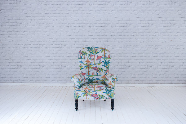 A Victorian (1837-1901) spoonback armchair upholstered in Foy & Co Monkey Puzzle cotton