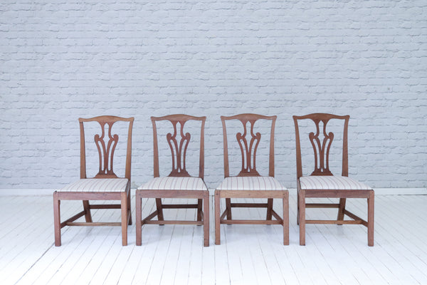 A set of four Georgian (1713-1830) period dining chairs