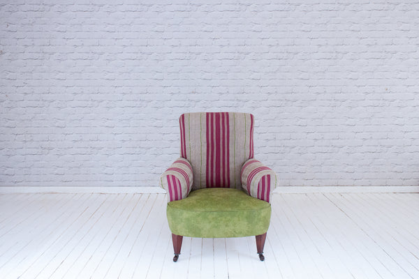 A Victorian deep seated armchair in vintage Asoke cloth and lime green distressed leatherette
