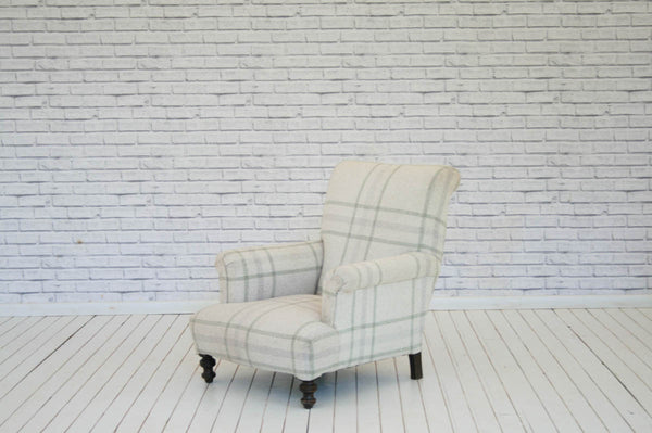 A Victorian armchair upholstered in 100% wool check