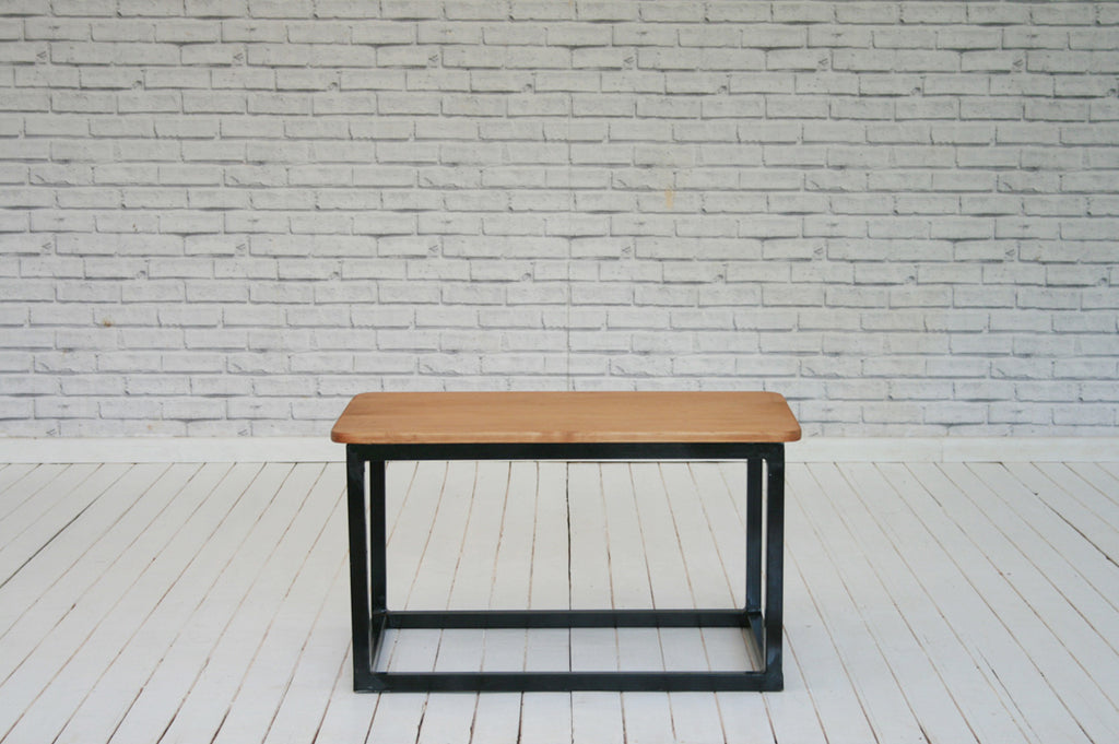 A vintage English pine paneled door coffee table