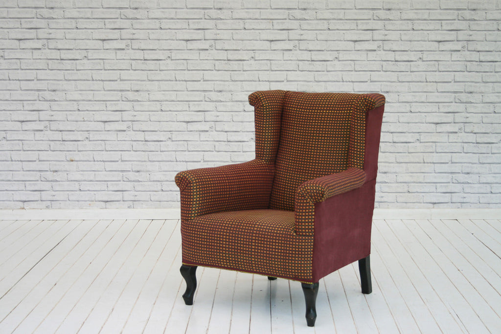 An Edwardian wingback armchair in West African Ewe cloth