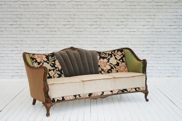 A 1930's Danish shell-back three seater sofa on cabriole front legs