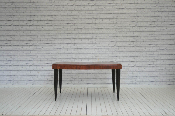 A Deco style dining table on tapering legs