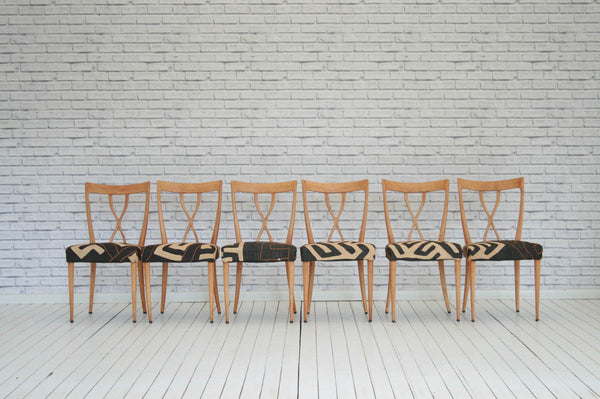 A set of six 1950s Italian dining chairs upholstered in African Bakuba cloth
