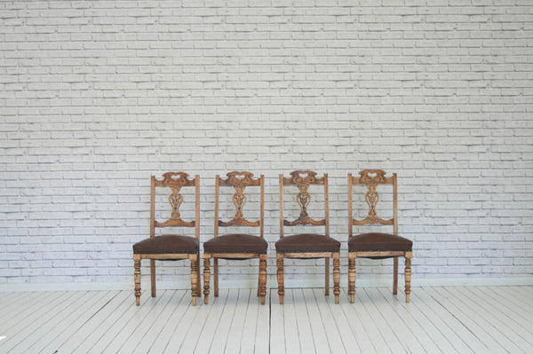 A set of four carved Victorian dining chairs