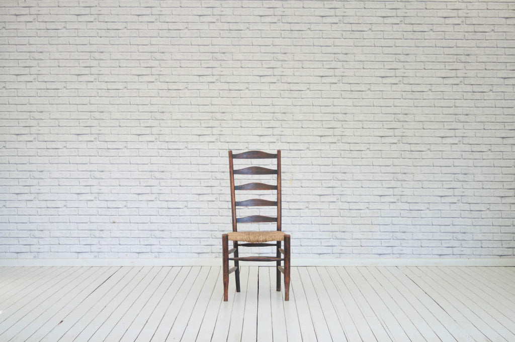 An oak ladder back kitchen chair with original rush seat/Kitchen chair